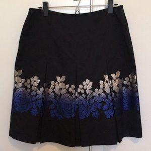 Midnight blue skirt with metallic floral motif